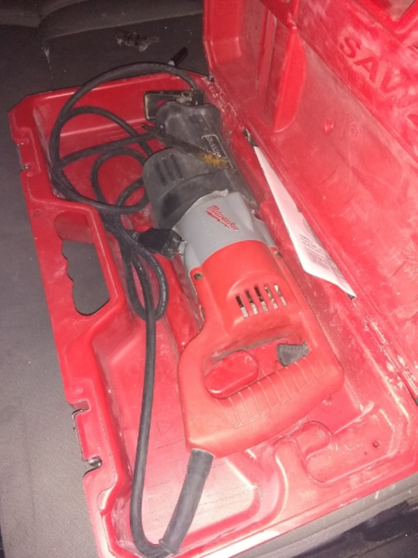 red and black Hilti corded power tool