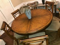 Ashley 5 foot dining table with 6 chairs. Rug can go with it for free Dora, 35062