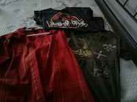 three assorted color shirts