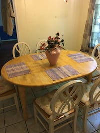 Wooden kitchen table with placemats and chairs with cushion Fayetteville, 30214