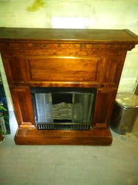 Real flame wood substitute fireplace.