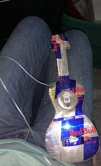 Guitar made out of red bull cans