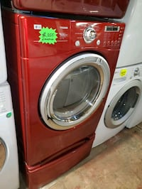 LG front load electric dryer with pedestals working perfectly  Baltimore, 21223