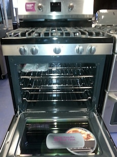 #1450 brand new stainless-steel Frigidaire gas sto