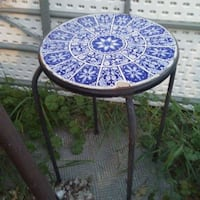 Vintage ceramic garden stool,  wooden serving cart,  lots of tags on new winter coats etc  Kelowna, V1Y 4Y2