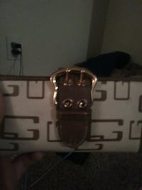 brown and white leather purse