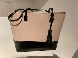 Black and pink kate spade leather tote bag..