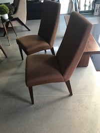 two brown wooden framed black padded chairs Trois-Rivières, G9A
