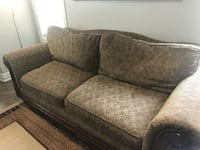 gray and brown floral fabric 2-seat sofa
