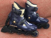 Blue-and-black Rollerblade inline skates, woman size 7 (used only once, will add carrying bag plus knee/elbow protective pads)
