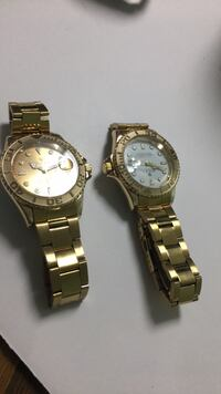 two round silver analog watches with link bracelets Washington