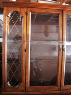 brown wooden frame glass china cabinet
