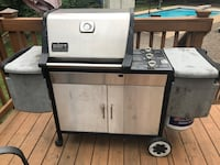 Genesis stainless weber gas grill with propane tank.  Has rusted hole at the bottom but over still great shape.  Just has some parts replaced.  Everything works Oakton, 22124