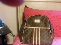 brown and black Louis Vuitton leather backpack Marrero, 70072