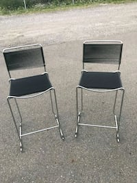 two black metal folding chairs Montreal, H8N