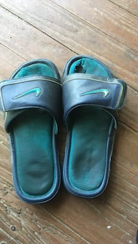 pair of black-and-green Nike slide sandals Foley, 36535