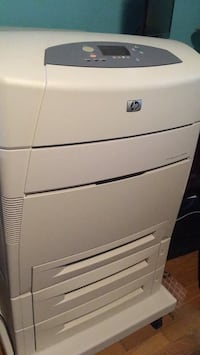HP Color Laserjet 5550dtn with 4 trays and rolling wheels. Plaistow, 03865