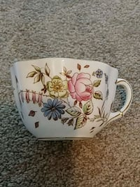 white and multicolored floral ceramic mug 1992 mi