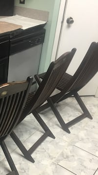 Teakwood folding chairs 4.  Beautiful chairs possible older antiques Firman brand.  Houston, 77339