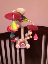 baby's pink and green crib mobile null