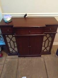 Table with four doors and three drawers
