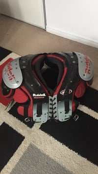 Red and black ruddell shoulder pad Burlington, L7S 1E3