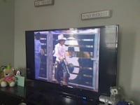 black flat screen TV with brown wooden TV hutch Clarksville, 37043