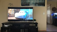 black flat screen TV with black wooden TV stand Calgary, T3J 4W5