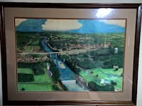 """Unique colored pencil drawing of Tuscaloosa/Northport/Black Warrior River.  Drawn by an inmate in the Tuscaloosa County Jail in about 1983.  Professionally framed by """"Picture This"""" in Tuscaloosa, Alabama."""