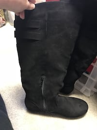 pair of brand new black suede knee-high boots