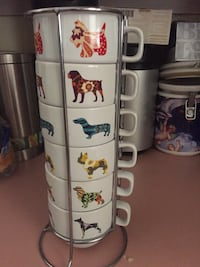 Tower of artistic dog mugs