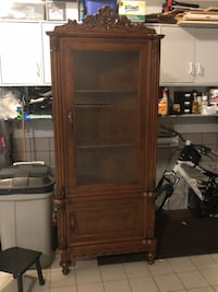 Brown wooden framed glass cabinet Laval, H7E 5P2