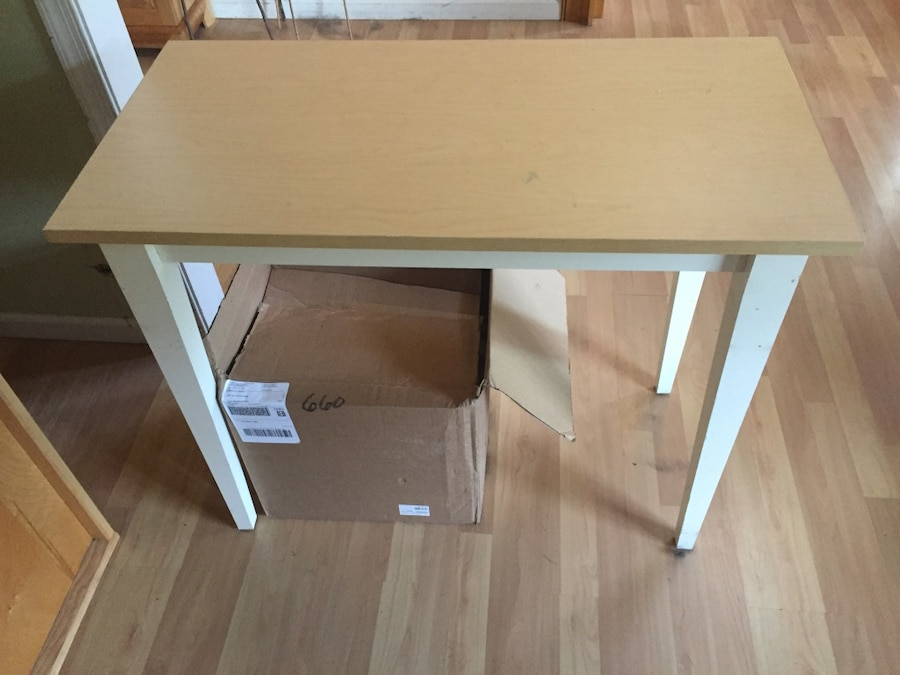 Light and white wood table. Approximately 3 feet wide. Great condition.