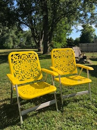Two retro style yellow folding chairs  Clinton Township, 48035