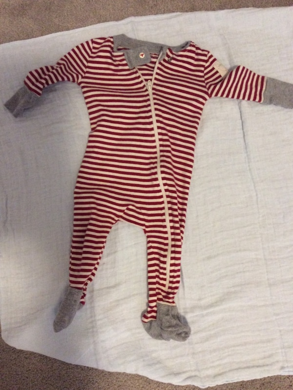 df73e4eee Used Baby s red and white stripe footie pajamas for sale in ...
