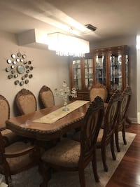 brown wooden dining table with chairs 536 km