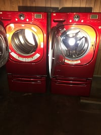 two red front-load clothes washer and dryer set