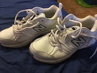 Pair of white new balance athletic shoes