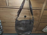 BROWN LEATHER ROOTS BUCKET BAG Burlington, L7P 2V3