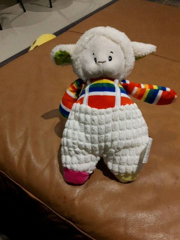 white and multicolored animal plush toy