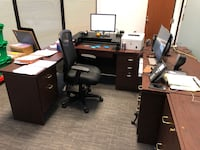 Office desk with file cabinet.