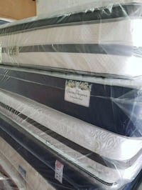 white and black mattress pack Opa-locka