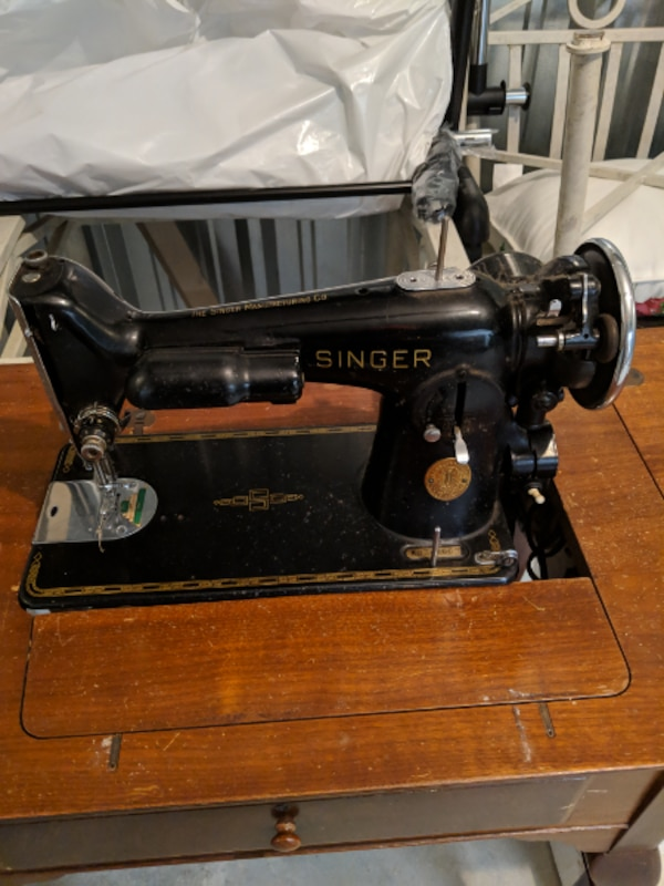 Singer antique sewing machine in table