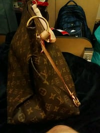 brown and black monogram Louis Vuitton leather tote bag Calgary
