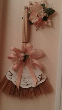 brown and white broom lace wall decor