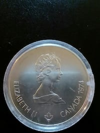 1974 round silver-colored Elizabeth Cana nickle