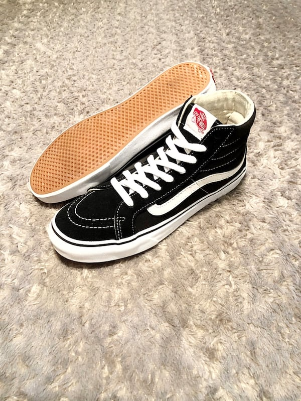 Vans hi-top paid $80 size 7 good condition women's size 8.5 . Black with white stitching. 75b62dfb-54af-4517-9ab8-52c5e76a22c8