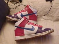 pair of white-and-red Nike basketball shoes Tampa, 33613