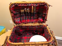 Wicker picnic basket.  Includes 2 knives, forks, spoons, and plates. Wentzville, 63385