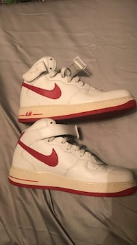 white-and-red Nike Air Force 1 high tops sneakers